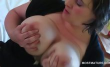 BBW slutty mature licking her sexy big nipples in bed