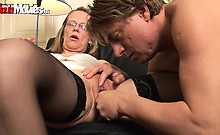A horny mature couple fuck on the sofa